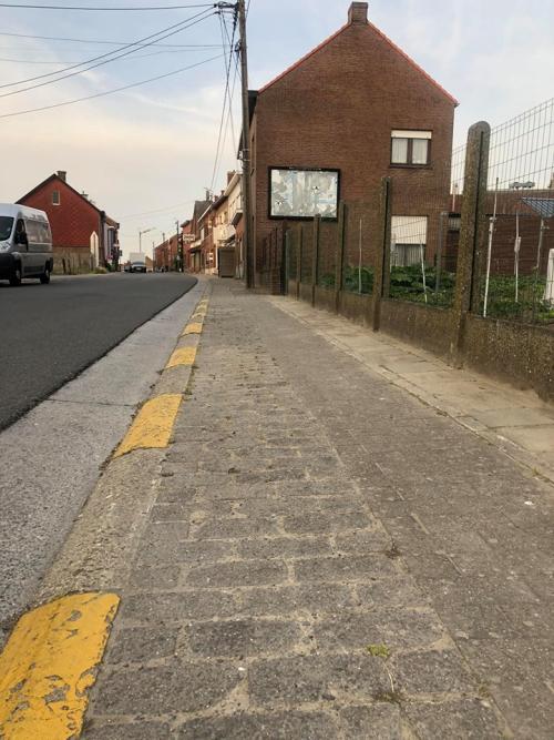 Voetpaden schoolstraat voor heraanleg foto 2